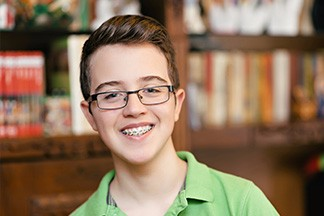 Teenage boy with braces smiling